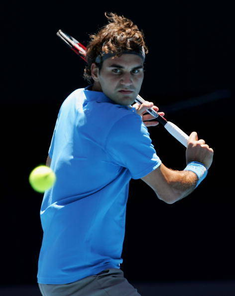 MELBOURNE, AUSTRALIA - JANUARY 17: Roger Federer of Switzerland plays a backhand during his second round match against Fabrice Santoro of France on day four of the Australian Open 2008 at Melbourne Park on January 17, 2008 in Melbourne, Australia. (Photo by Cameron Spencer/Getty Images)